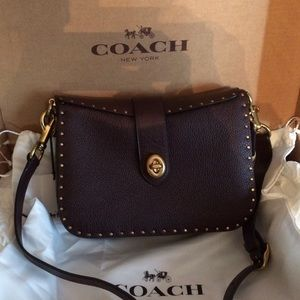 Coach Page 27 with rivets